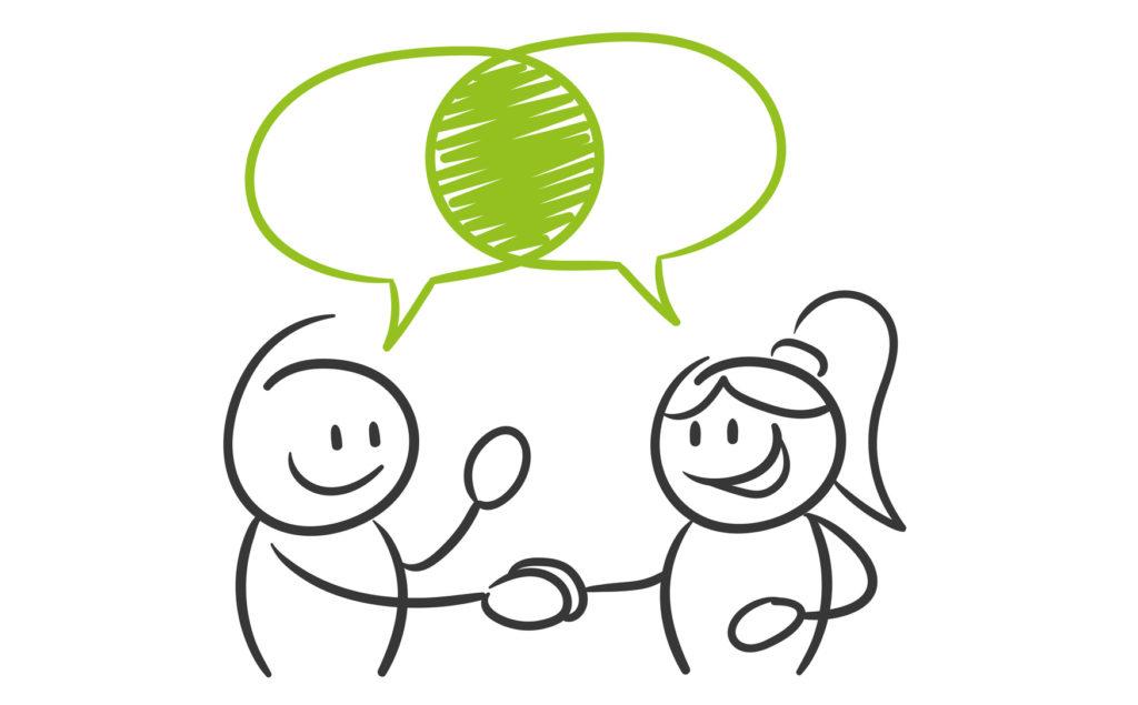 Mediacja - obrazek przedstawia dwie osoby, które podają sobie rękę na znak porozumienia.